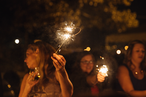sparklers and wedding guests